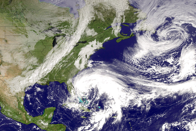 Hurricane Sandy churns off the coast of Florida as a line of clouds associated with a powerful cold front approaches the U.S. East Coast on Oct. 26, 2012